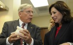 Jenkins demonstrates a 3-D printing model with former Labor Secretary Hilda Solis.