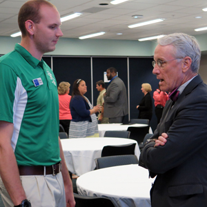 SPC President Bill Law talks with a student at the Pizza with the President event.