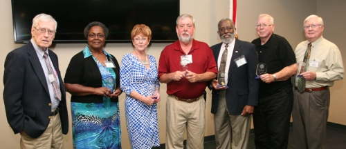 SPC Career Service Employee Retiree Emeritus Luncheon recognized seven outstanding retired Career Service employees. From left: Jim Moorhead, Shirley Bell, Sherry Armstrong, JR Lenges, Joseph Smith, Harry Berger and Morrie Johnson.