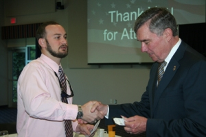 An SPC Public Policy student Nicolas Louis interacting with Commissioner Kerlikowske.