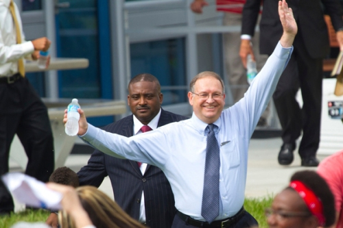 James Olliver, celebrates in 2012, when President Barack Obama held a rally on Seminole Campus.