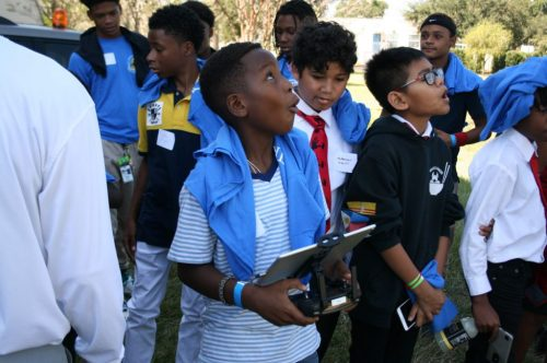 Photo of boys flying drones at Keys to Manhood event
