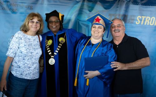 Photo of graduate, family and President Tonjua Williams at SPC Fall 2019 graduation ceremonies