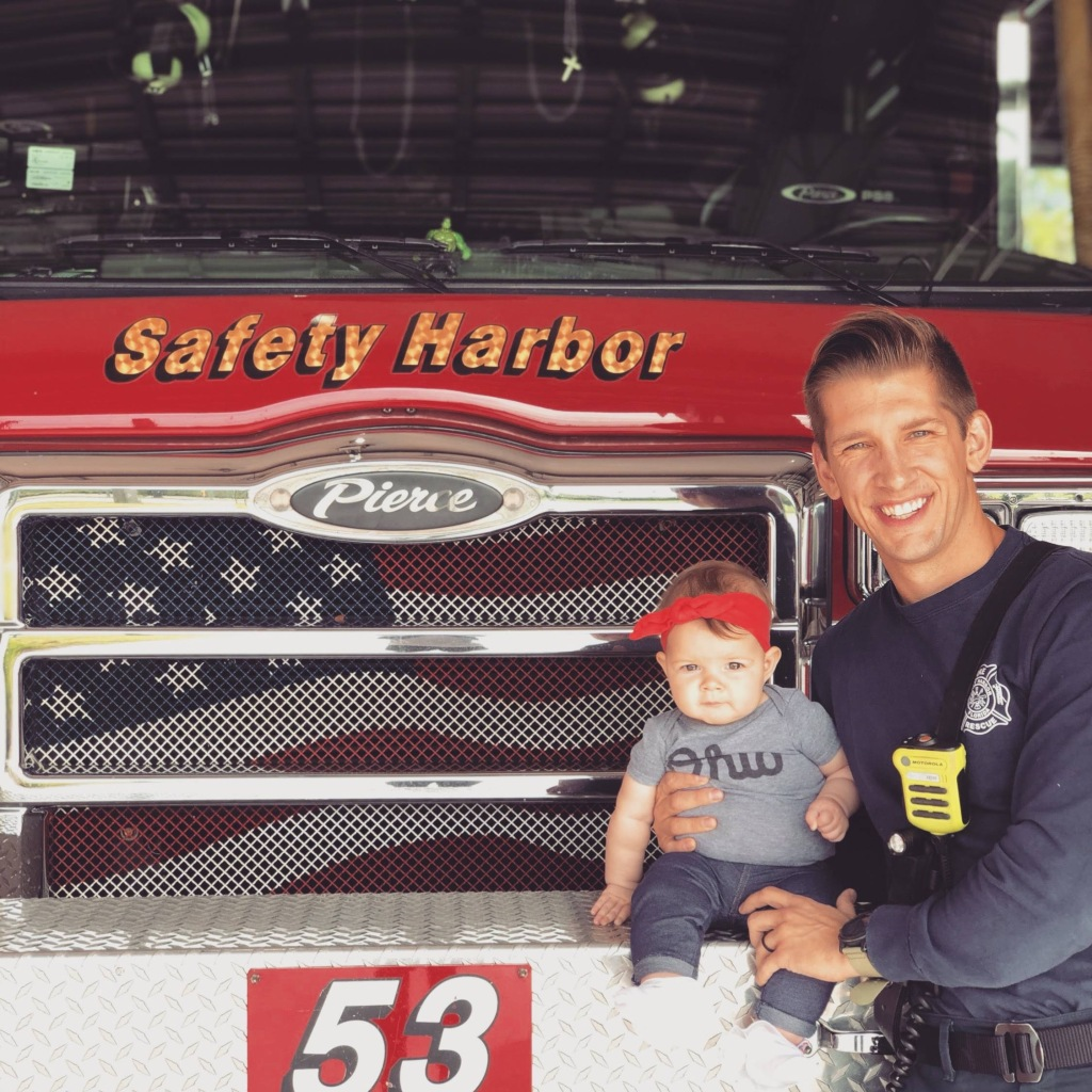 Andrew Portale with daughter in front of fire engine