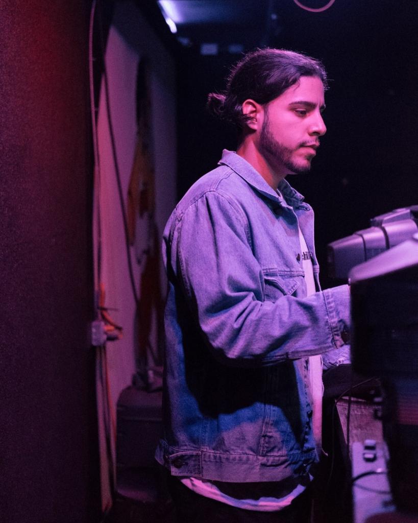 Riley Cruz works at a sound board