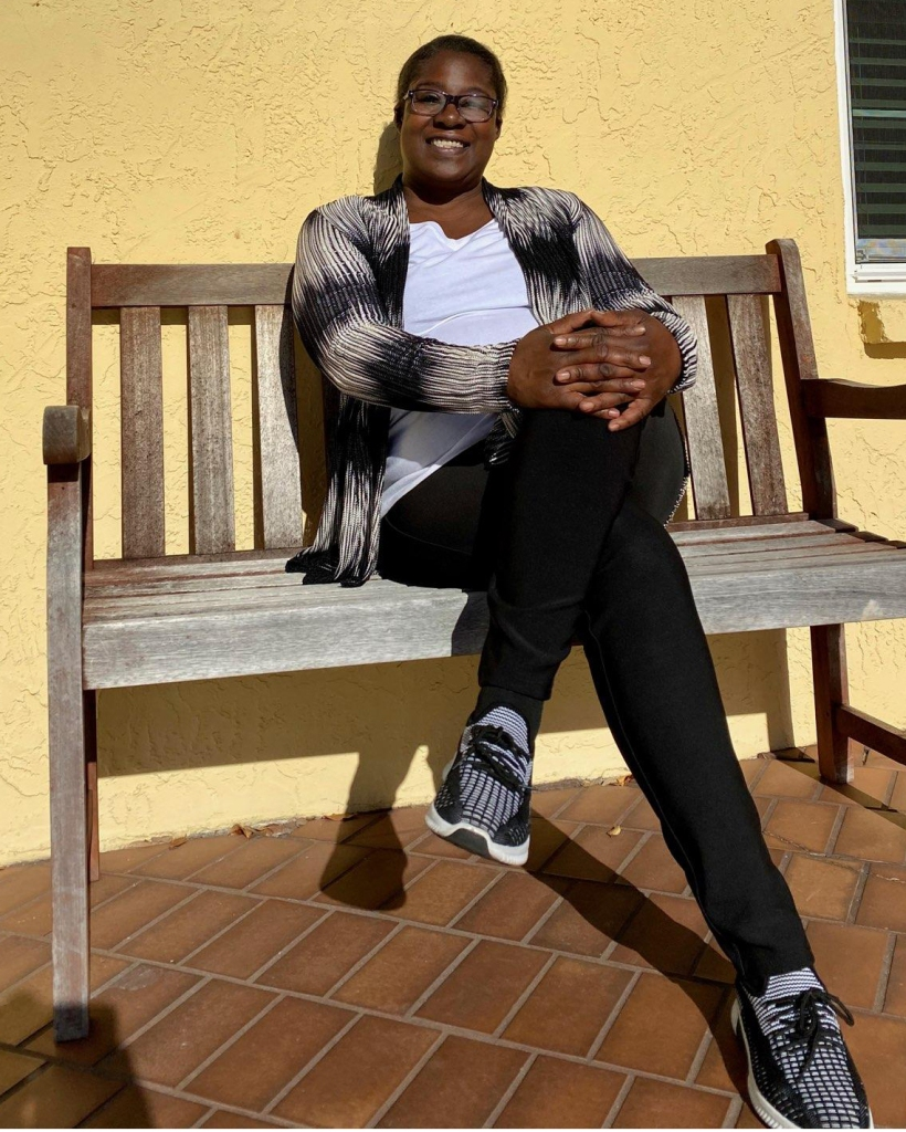 Tonya Glover-Carter sits on a bench