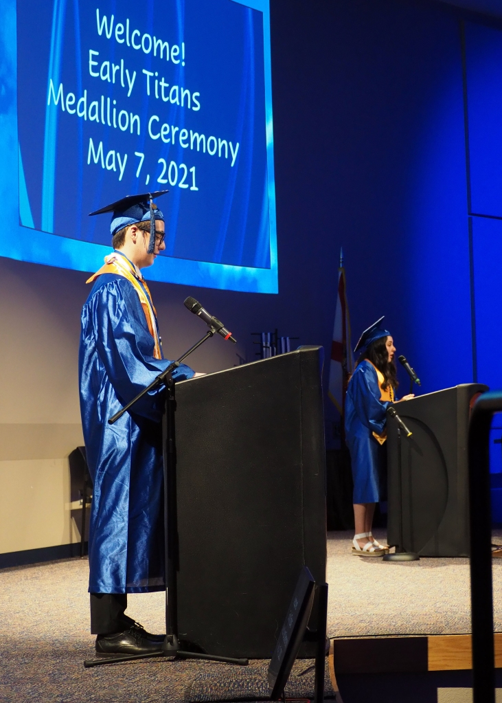 James and Nadia, behind separate podiums, give their commencement speech