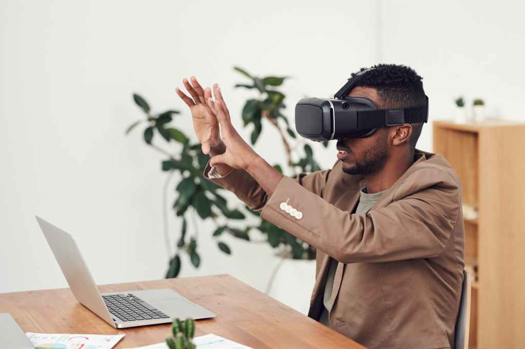 African American man wears virtual reality goggles